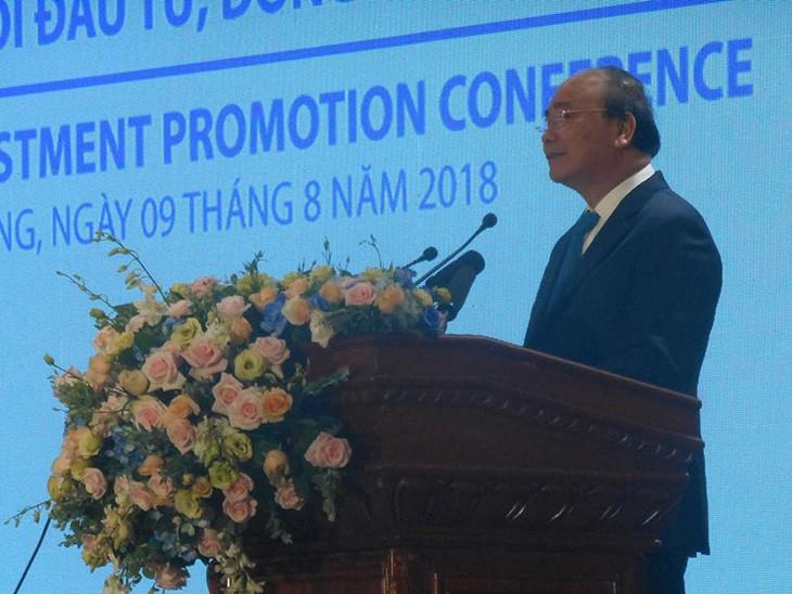 នាយករដ្ឋមន្ត្រីវៀតណាមលោក Nguyen Xuan Phuc ចូលរួមសន្និសីទពន្លឿនការវិនិយោគនៅខេត្ត Tien Giang ឆ្នាំ ២០១ - ảnh 1