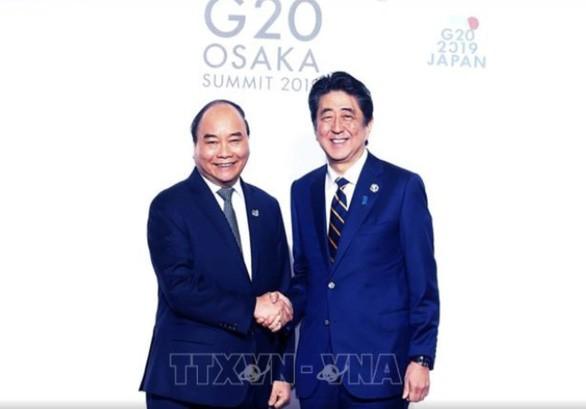 នាយករដ្ឋមន្រ្តីវៀតណាមលោក Nguyen Xuan Phuc អញ្ជើញចូលរួមសកម្មភាពនានាក្នុងក្របខ័ណ្ឌកិច្ចប្រជុំ G20 - ảnh 1