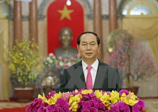 សារលិខិតជូនពរឆ្នាំថ្មី-ឆ្នាំរកានព្វស័ករបស់ប្រធានរដ្ឋ លោក Tran Dai Quang - ảnh 1