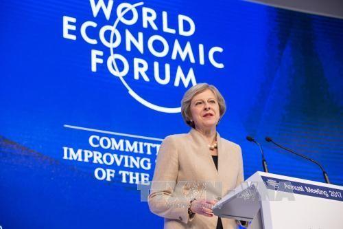 英国首相特雷莎•梅宣布英国将继续发挥引领世界经济的作用 - ảnh 1