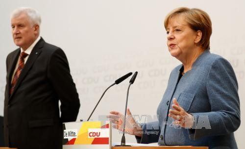 德国总理默克尔公布组阁谈判时间 - ảnh 1