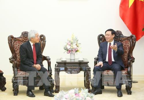 越南政府副总理王庭惠会见日本控股集团首席执行官伸足立 - ảnh 1