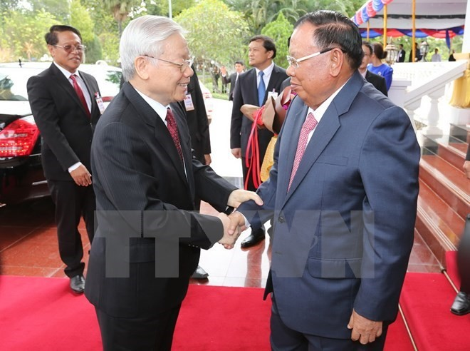 Party leader's visit provides momentum for greater Vietnam-Lao cooperation  - ảnh 1
