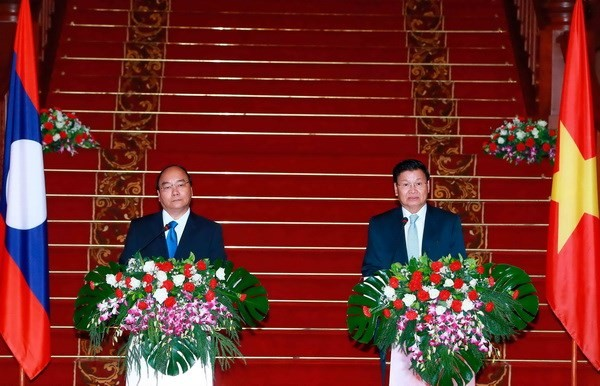 Vietnam, Laos to boost traditional ties, special solidarity  - ảnh 1
