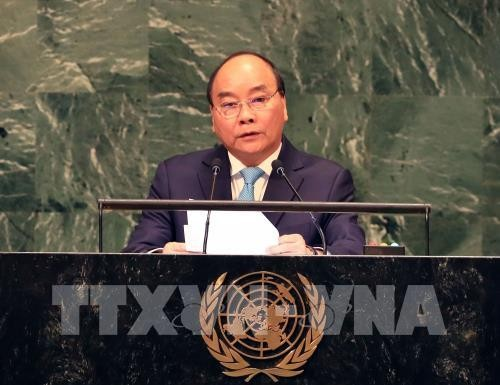 PM calls for joint efforts for world of sustainable development - ảnh 1