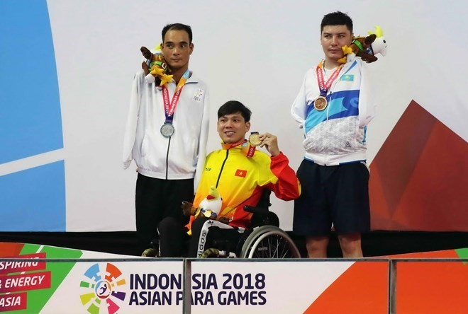 Vietnamese swimmer wins another gold medal at 3rd Asian Para Games - ảnh 1