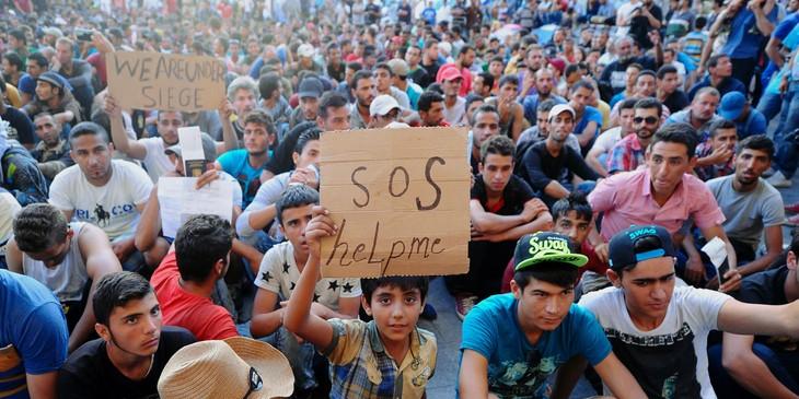 L'Europe s'affronte sur les quotas, nouveaux records de migrants - ảnh 1