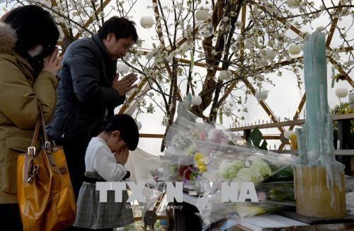 Mengenangkan 7 tahun musibah gempa bumi dan tsunami di Jepang - ảnh 1