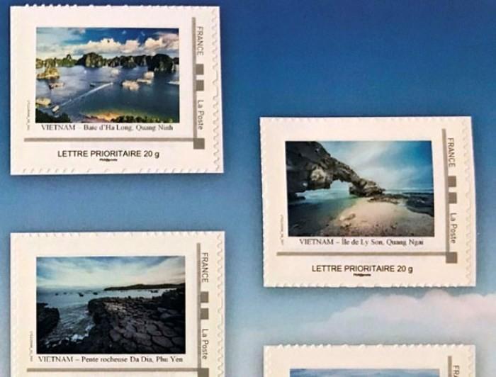 Mahasiswa Viet Nam di Perancis dengan perangko bergambarkan laut dan pulau kampung halaman - ảnh 1