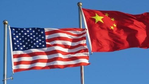 Ekonomi dunia dalam pusaran perdagangan AS-Tiongkok - ảnh 1
