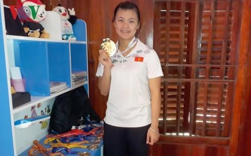 Atlet Quang Thi Thu Nghia-Gadis emas pencak silat dari etnis minoritas Thai - ảnh 1