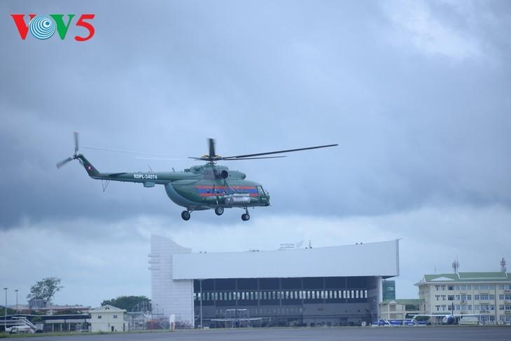 ພິທີມອບຮັບເຮືອບິນເອລີກອບເຕີ Mi -17 ຂອງລັດເຊຍ ໃຫ້ແກ່ກອງທັບອາກາດສປປລາວ - ảnh 8