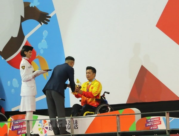 ຫວຽດນາມ ຄ້ວາໄດ້ຫຼຽນຄຳທີ່ງານມະຫາກຳກິລາຄົນພິການ Asian Para Games 2018 - ảnh 1