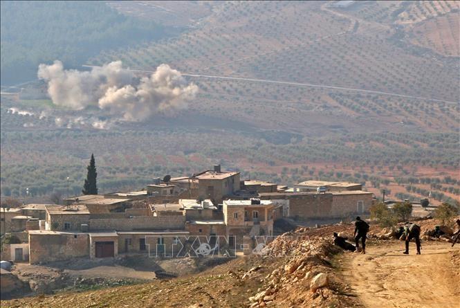 ກອງທັບຊີຣີ ບຸກໂຈມຕີເຂດດ້ວຍການ ຍິງປືນໃຫຍ່ເຂົ້າຊາວ Kurd ຢູ່ ຊີຣີ - ảnh 1