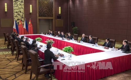 中比首脳会談 経済協力など通じ関係強化で一致 - ảnh 1