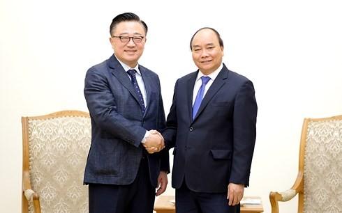 フック首相、韓国サムスン無線事業部長と会見 - ảnh 1