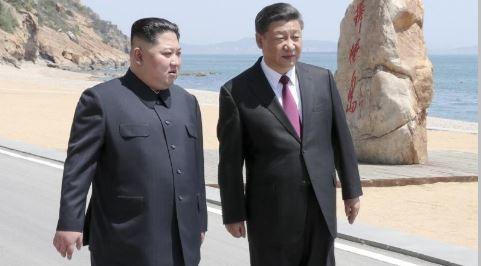 朝鮮民主主義人民共和国の金正恩氏、中国で習主席と再会談 - ảnh 1