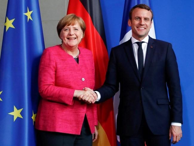 独仏首脳が会談 ユーロ圏共通予算創設で一致 - ảnh 1