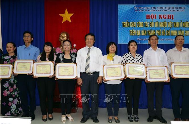 国外在留ベトナム人 ホーチミン市の発展に貢献 - ảnh 1