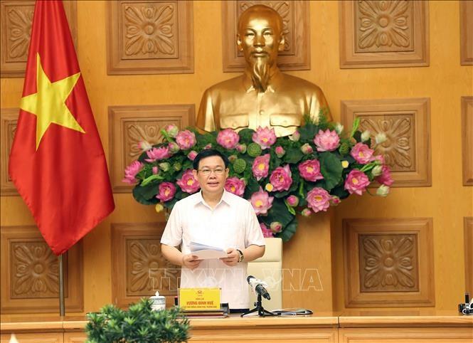 フエ副首相:国営企業の株式化を加速させる必要がある - ảnh 1