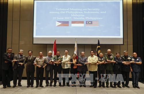 Filipina, Malaysia dan Indonesia berkomitmen akan bekerjasama erat  melawan IS - ảnh 1