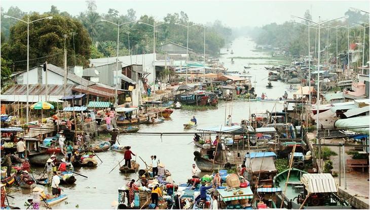 Pasar terapung Nga Nam kaya dengan budaya air daerah dataran rendah sungai Mekong - ảnh 2
