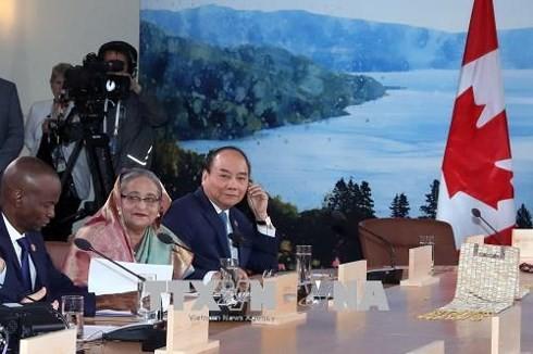 "PM Viet Nam, Nguyen Xuan Phuc mengeluarkan gagasan tentang ""Mekanisme kerjasama global mengenai  pengurangan sampah plastik""  di depan KTT G7 yang diperluas  - ảnh 1"