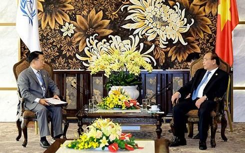 PM Vietnam, Nguyen Xuan Phuc  menerima para pemimpin dari organisasi-organisasi  internaisonal  yang menghadiri GEF6 - ảnh 1