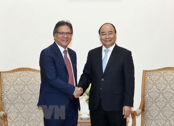 PM Viet Nam, Nguyen Xuan Phuc menrima Direktur Jenderal Badan Pengelolaan dan Penjaminan Efektivitas  Pemerintah Malaysia - ảnh 1