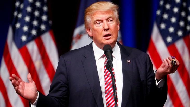 Presiden AS, Donald Trump memperingatkan akan terus  menimbulkan  tekanan terhadap ekonomi Tiongkok - ảnh 1