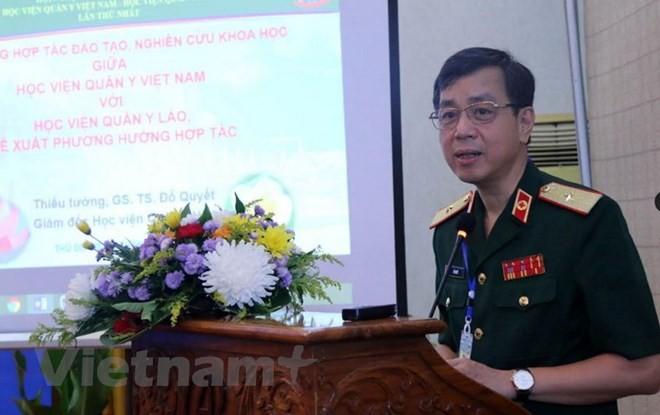 Viet Nam dan Laos memperkuat  kerjasama di bidang ilmu kedokteran militer - ảnh 1
