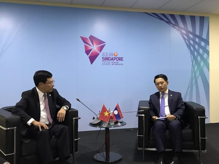 Activités de Pham Binh Minh en marge de la 51e conférence des ministres des AE de l'ASEAN - ảnh 1