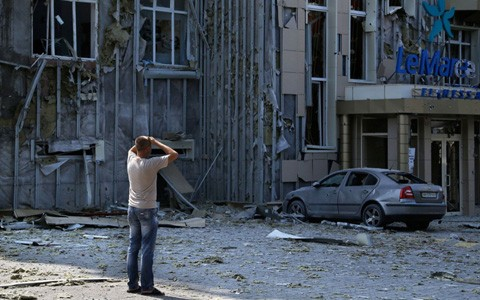 ウクライナ 独仏調停も戦闘続く - ảnh 1
