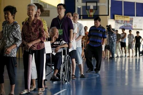 シンガポール総選挙 投票始まる - ảnh 1