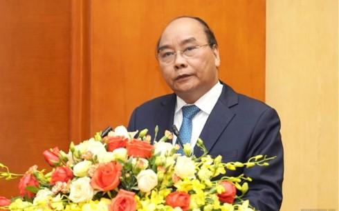 フック首相、28号決議の実施状況を総括する会議に出席 - ảnh 1