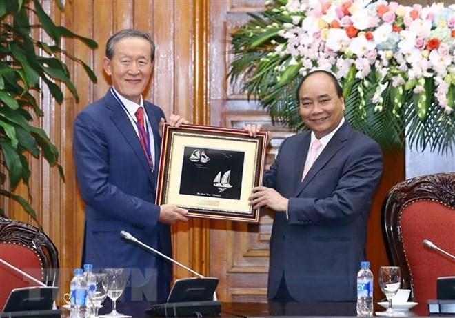 越南政府总理阮春福会见韩国产业联合会主席许昌洙 - ảnh 1