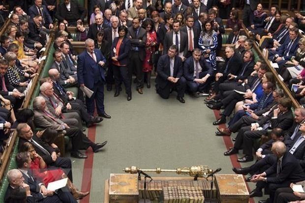 """英国议会下院投票支持推迟""""脱欧"""" - ảnh 1"""