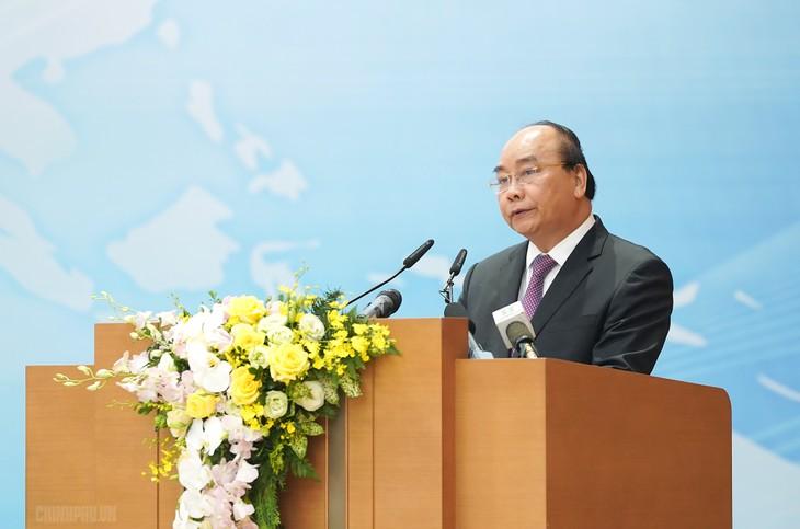 阮春福主持融入国际国家指导委员会5年工作总结会议 - ảnh 1