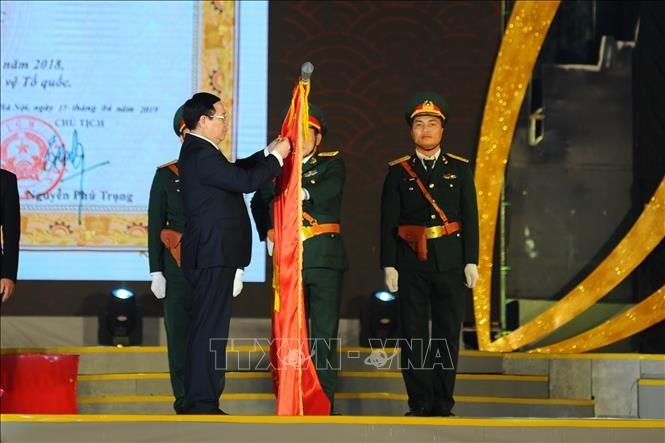 Nghi Lôc reçoit l'Ordre du Travail  - ảnh 1