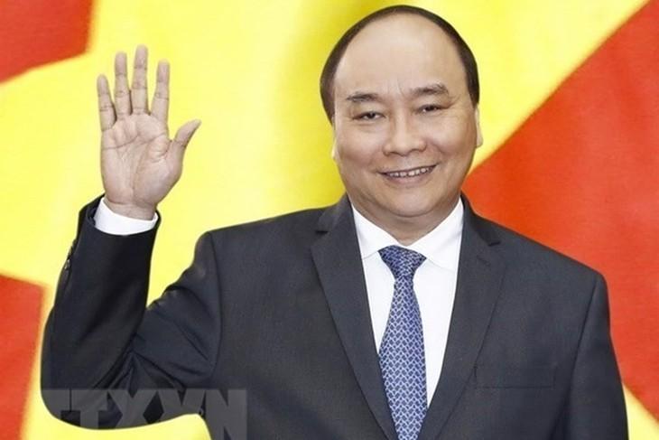 Premierminister Nguyen Xuan Phuc beginnt seine Teilnahme am erweiterten G7-Gipfel - ảnh 1