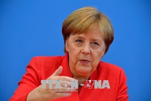 Russlands Präsident Putin trifft Bundeskanzlerin Merkel in Berlin - ảnh 1