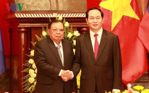 陈大光会见老挝人民革命党中央总书记、国家主席本扬·沃拉吉 - ảnh 1