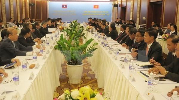 越南与老挝加强合作管理共同边界线 - ảnh 1