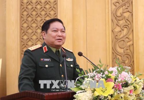 越南国防部长吴春历与人民军总政治局和总后勤局举行工作座谈会 - ảnh 1