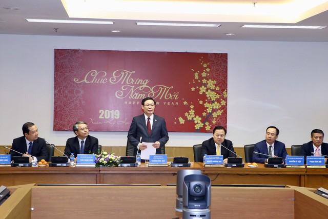 Vizepremier Vuong Dinh Hue besucht die Kommission zur Verwaltung staatlichen Kapitals, Agribank und VNPT - ảnh 1