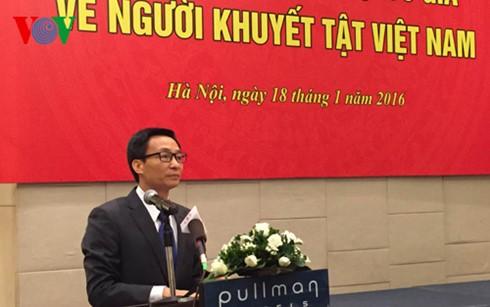 Deputi PM Vietnam, Vu Duc Dam menghadiri acara unjuk muka Komite Nasional urusan penyandang disabilitas Vietnam - ảnh 1