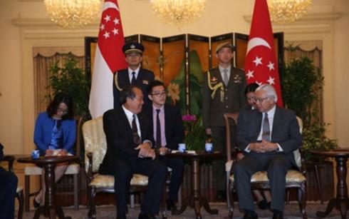 Deputi PM Vietnam, Truong Hoa Binh melakukan kunjungan resmi di Singapura - ảnh 1