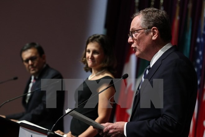 Tiga negara Amerika Utara memasuki putaran perundingan yang menentukan bagi masa depan NAFTA - ảnh 1