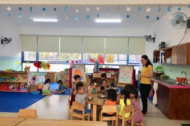 Sekolah yang berstandar internasional untuk anak-anak kaum buruh miskin di Kota Da Nang - ảnh 2