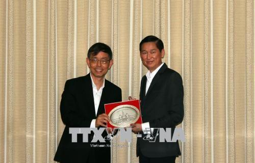 Kota Ho Chi Minh dan Singapura mendorong kerjasama dalam membangun kota pintar - ảnh 1